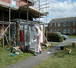 Asbestos Removal contractor in protective clothing